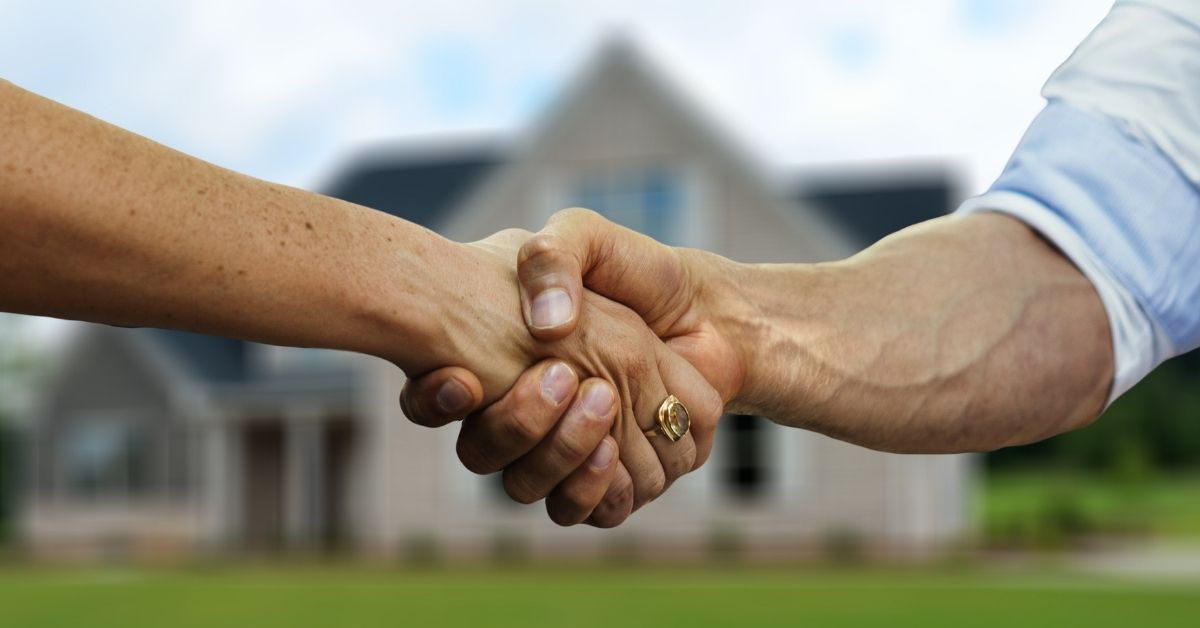 Two people shaking hands agreeing to the sale of a real estate property in Whitby