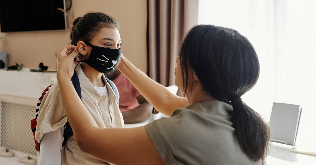Mom putting mask on daughter before sending to dad's house in Whitby as they co-parent during covid-19
